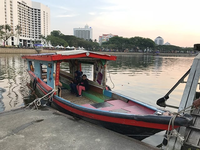 Catch the boat across the Sarawak River to the open air food court