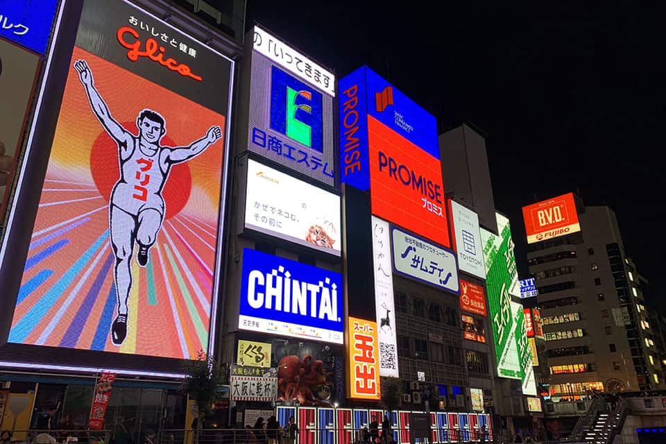 Famous tourist attraction glico running man neon lights Dotonbori